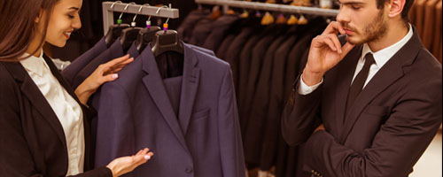 customer shopping for blue suit
